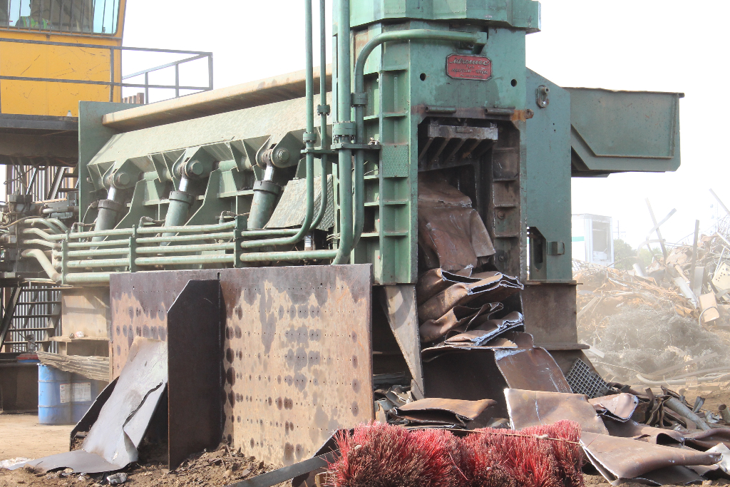 machine-to-flatten-metal-for-recycling